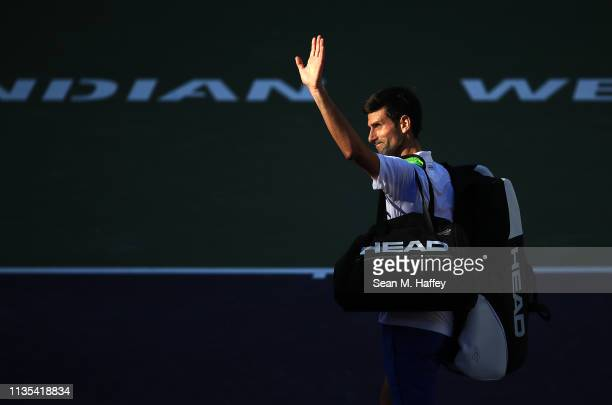 Novak Djokovic of Serbia waves to the crowd after being defeated by Philipp Kohlschreiber of Germany 64 64 in their men's singles match on day nine...