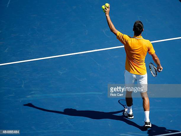 Novak Djokovic of Serbia waves to the crowd after defeating Alexandr Dolgopolov of the Ukraine in three sets during the semifinals of the Western...
