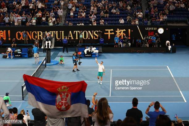 Novak Djokovic of Serbia waves to the crowd following victory in his Men's Singles Semifinals match against Aslan Karatsev of Russia during day 11 of...