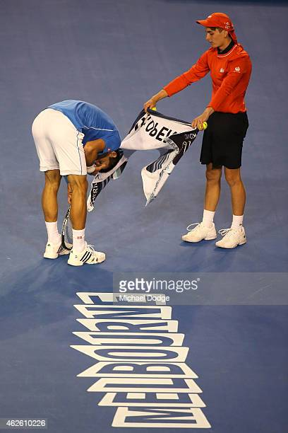 Novak Djokovic of Serbia winces in pain in his men's final match against Andy Murray of Great Britain during day 14 of the 2015 Australian Open at...