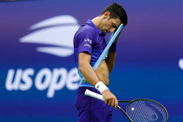 Novak Djokovic of Serbia wipes the sweat off his forehead against Holger Vitus Nodskov Rune of Denmark during his Men's Singles first round match on...