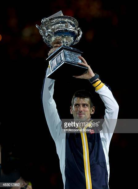 Novak Djokovic of Serbia with the Norman Brookes Challenge Cup after winning his men's final match against Andy Murray of Great Britain during day...