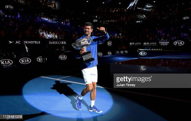 Novak Djokovic of Serbia with the Norman Brookes Challenge Cup following victory in his Men's Singles Final match against Rafael Nadal of Spain...