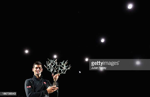 Novak Djokovic of Serbia with the winners trophy after defeating David Ferrer of Spain in the final during day seven of the BNP Paribas Masters at...