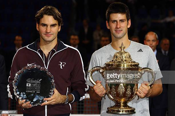 Novak Djokovic of Serbia with the winners trophy after defeating Roger Federer of Switzerland in the final during Day Seven of the Davidoff Swiss...