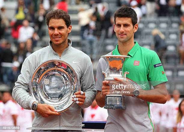 Novak Djokovic of Serbia with the winners trophy next to runner up Rafael Nadal of Spain after the final during day eight of the Internazionali BNL...