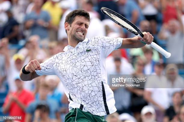 Novak Djokovic of Serbis celebrates his win over Roger Federer of Switzerland during the men's final of the Western & Southern Open at Lindner Family...