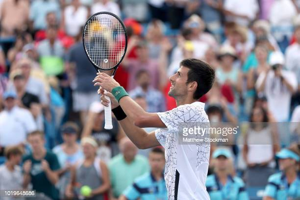 Novak Djokovic of Serbis celebrates his win over Roger Federer of Switzerland during the men's final of the Western Southern Open at Lindner Family...