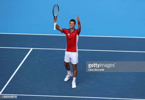 Novak Djokovic of Team Serbia celebrates victory after his Men's Singles First Round match against Hugo Dellien of Team Bolivia on day one of the...