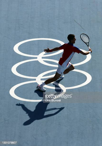 Novak Djokovic of Team Serbia chases down a return during his Men's Singles Third Round match against Alejandro Davidovich Fokina of Team Spain on...