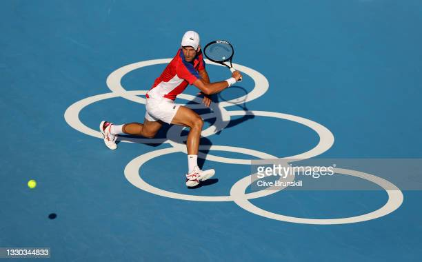 Novak Djokovic of Team Serbia plays a backhand during his Men's Singles First Round match against Hugo Dellien of Team Bolivia on day one of the...