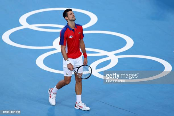 Novak Djokovic of Team Serbia reacts after a point during his Men's Singles Bronze Medal match against Pablo Carreno Busta of Team Spain on day eight...