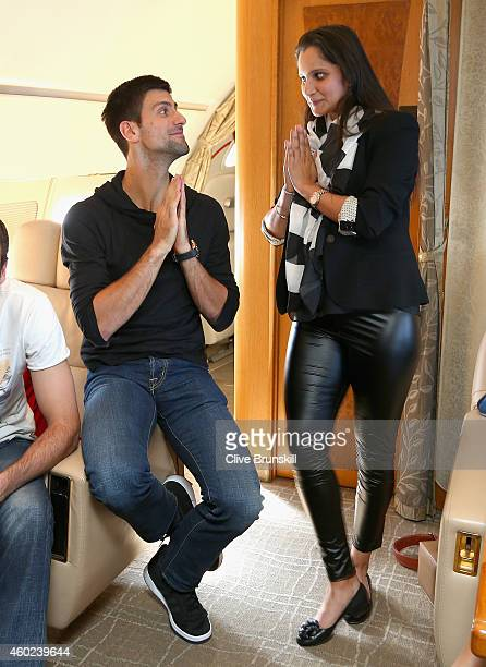 Novak Djokovic of the UAE Royals has fun with Sania Mirza of the Indian Aces during the private players flight from DelhiIndia to Dubai prior to the...