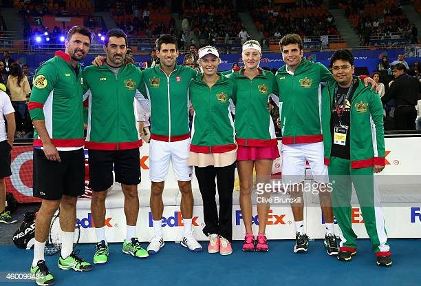 Novak Djokovic of the UAE Royals makes his debut as his team pose for a group photograph before their tie against the Manila Mavericksduring the...