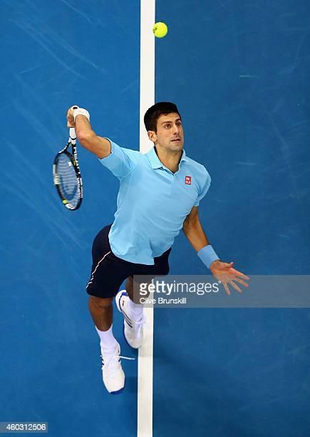 Novak Djokovic of the UAE Royals serves against Jo-Wi;lfried Tsonga of the Manila Mavericks during the Coca-Cola International Premier Tennis League...