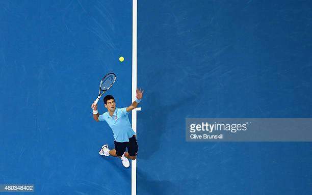 Novak Djokovic of the UAE Royals serves against Jo-Wilfried Tsonga of the Manila Mavericks during the Coca-Cola International Premier Tennis League...
