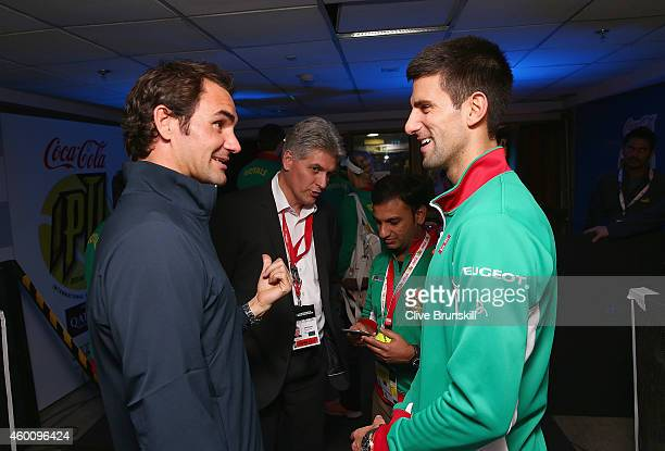 Novak Djokovic of the UAE Royals talks backstage with Roger Federer of the Indian Aces during the Coca-Cola International Premier Tennis League third...