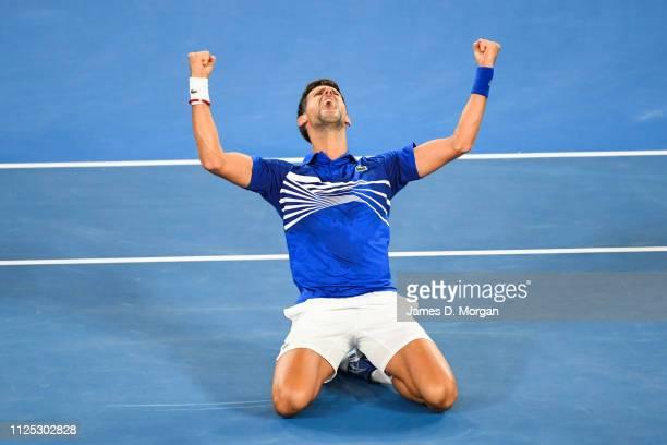Novak Djokovic on the ground cheering after winning the Men's Singles Final match between Novak Djokovic of Serbia and Rafael Nadal of Spain during...