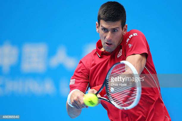 Novak Djokovic plays a backhand in his match against Guillermo Garcia-Lopez of Spain during day four of of the China Open at the National Tennis...