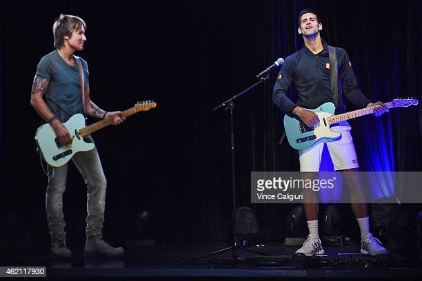 Novak Djokovic plays guitar at the ANZ Jam Slam on Grand Slam Oval with a hologram of Aussie music star Keith Urban during the 2015 Australian Open...
