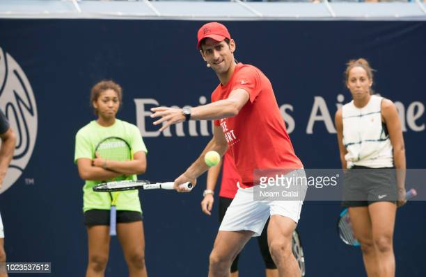 Novak Djokovic plays tennis during the 2018 Arthur Ashe Kids' Day at USTA Billie Jean King National Tennis Center on August 25 2018 in New York City