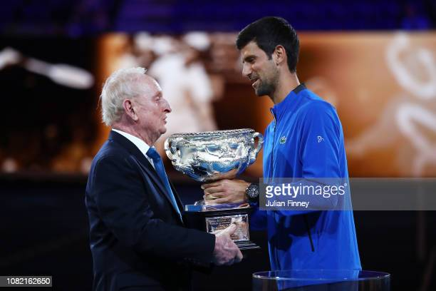 Novak Djokovic presents Rod Laver with the Norman Brookes Challenge Cup during the 50th anniversary celebration for Australian Open and Rod Laver's...