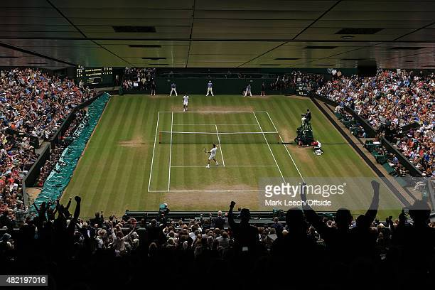 Novak Djokovic reacts as he defeats Roger Federer during the Men's final on day thirteen of the Wimbledon Lawn Tennis Championships at the All...