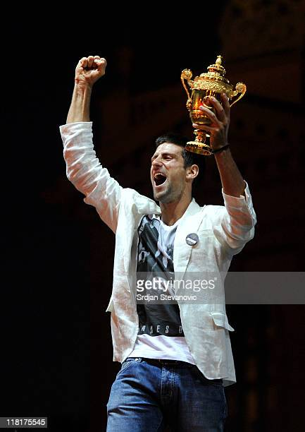 Novak Djokovic reacts as he lifts the Wimbledon men's singles championship trophy during a ceremony to welcome him home following his victory at the...