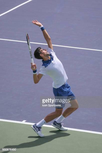 Novak Djokovic serves during the BNP Paribas Open on March 11 2018 at the Indian Wells Tennis Garden in Indian Wells CA