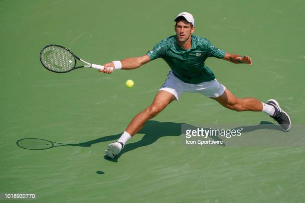 Novak Djokovic stretches to return a shot during the semifinal match at the Western Southern Open at the Lindner Family Tennis Center in Mason Ohio...