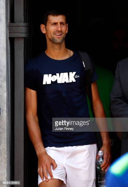 Novak Djokovic watches Simona Halep of Romania in her match against Naomi Osaka of Japan during day four of the Internazionali BNL d'Italia 2018...