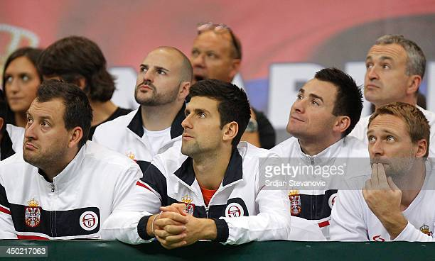 Novak Djokovic watches the men's singles match between Dusan Lajovic of Serbia and Radek Stepanek of Czech Republic on day three of the Davis Cup...