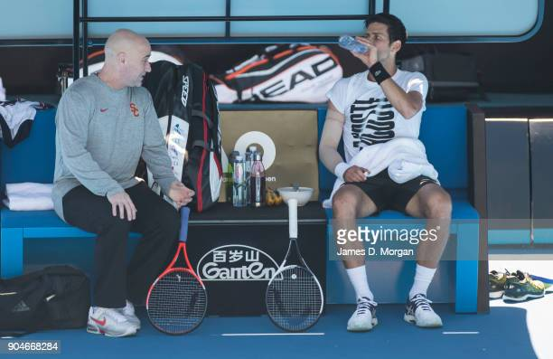 Novak Djokovic with coach Andre Agassi during a practice session ahead of the 2018 Australian Open at Melbourne Park on January 14 2018 in Melbourne...