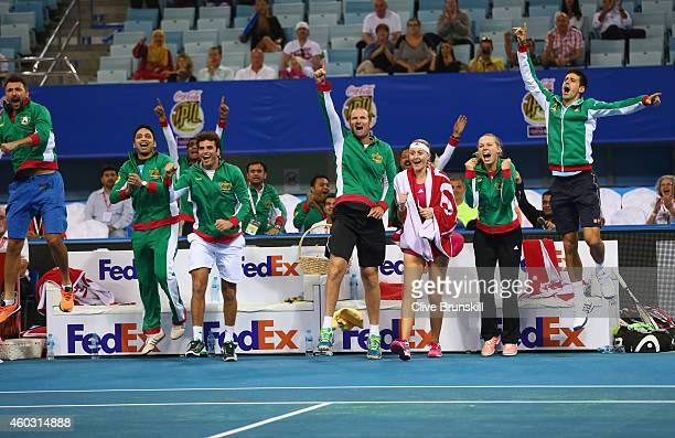 Novak Djokovic,Caroline Wozniacki,Kristina Mladenovic,John Leffine De Jager and the team bench of the UAE Royals all celebrate as team mates Nenad...