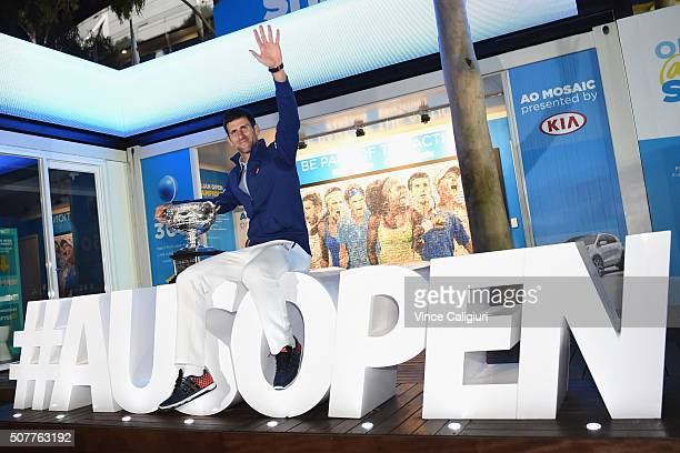 Novak Djokovik of Serbia poses on the ausopen hashtag after defeating Andy Murray of Great Britain in the Mens Final during day 14 of the 2016...