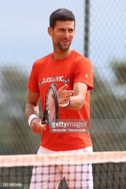 Novak Doković of Serbia smiles during a training session on day 2 of the Rolex Monte-Carlo Masters at Monte-Carlo Country Club on April 11, 2021 in...