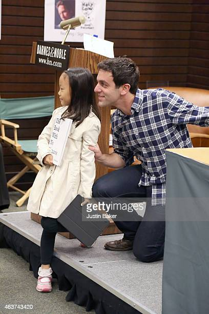 J Novak reads from his book Book With No Pictures for a young girl named Erin while promoting his new book One More Thing Stories and Other Storiesat...