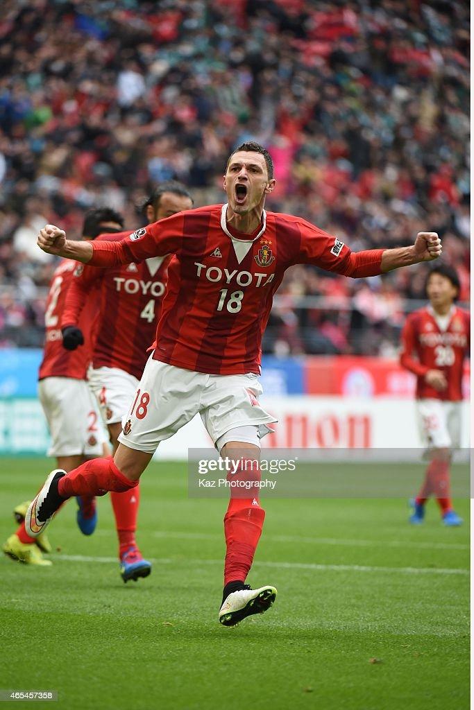 Novakovic of Nagoya Grampus celebrates 3rd goal during the J. League match between Nagoya Grampus and Matsumoto Yamaga at Toyota Stadium on March 7, 2015 in Toyota, Japan.