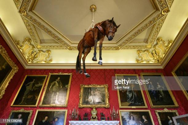 """Novecento"""", a taxidermy horse suspended from the ceiling, created by artist Maurizio Cattelan, is seen at Blenheim Palace on September 12, 2019 in..."""