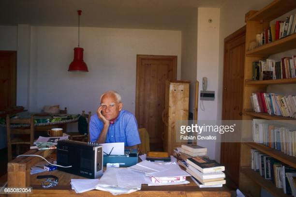 Novelist Alberto Moravia Sitting at Home
