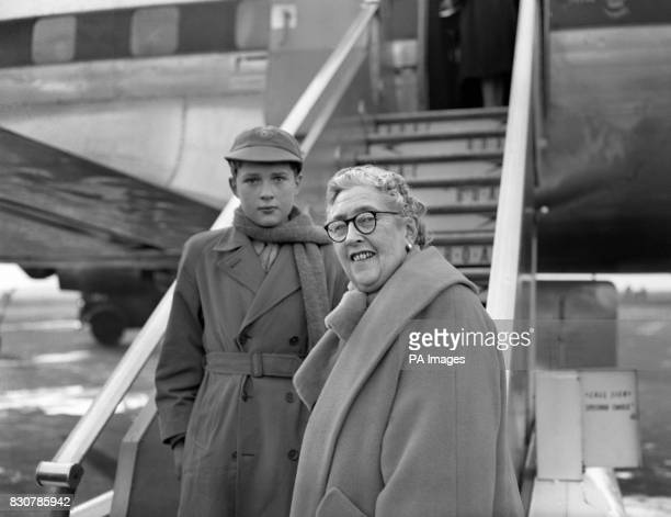 Novelist and playwright Agatha Christie and her grandson Matthew Pritchard leave London Airport to spend Christmas in Tripoli