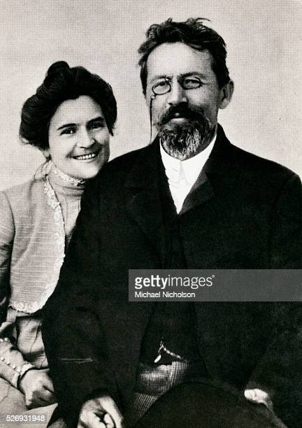 Novelist and playwright Anton Chekhov whose works include Uncle Vanya The Three Sisters and The Cherry Orchard sits beside his wife stage actress...