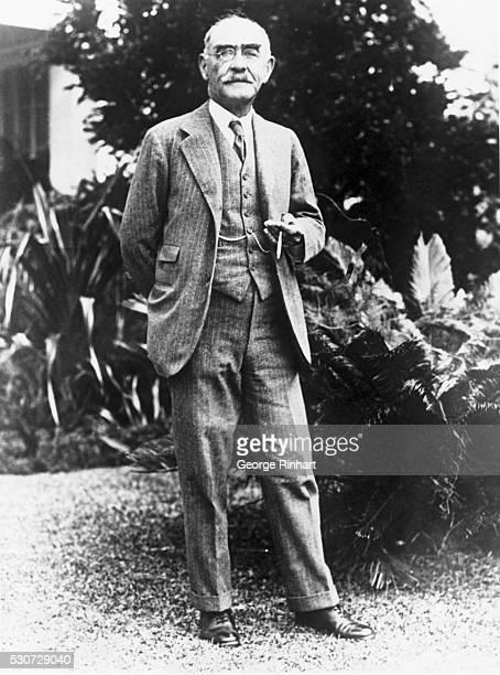 Novelist and poet Rudyard Kipling holds a cigar on his sixty-sixth birthday.