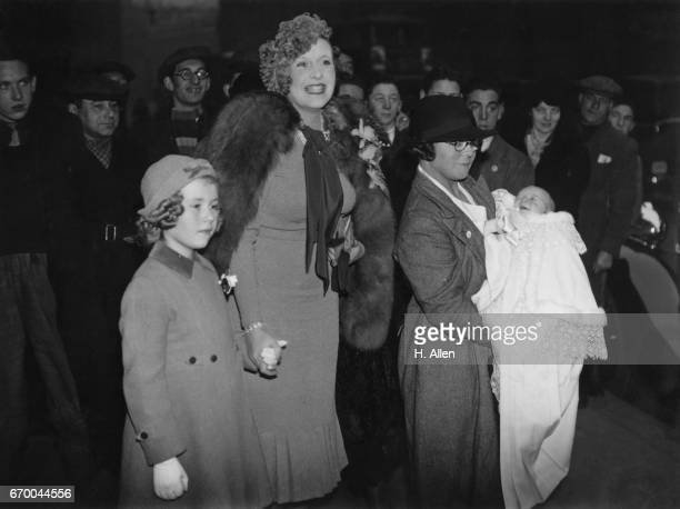 Novelist Barbara Cartland with her daughter Raine at the christening of her son Ian Hamilton McCorquodale 24th November 1937 The ceremony took place...