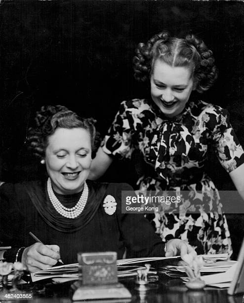 Novelist Barbara Cartland with her daughter Raine McCorquodale arranging her daughters upcoming wedding 1948
