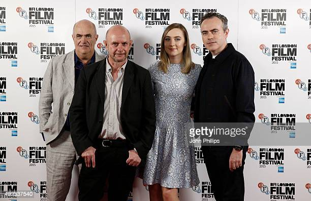 Novelist Colm Toibin screenwriter Nick Hornby actress Saoirse Ronan and director John Crowley attend a photocall for 'Brooklyn' during the BFI London...