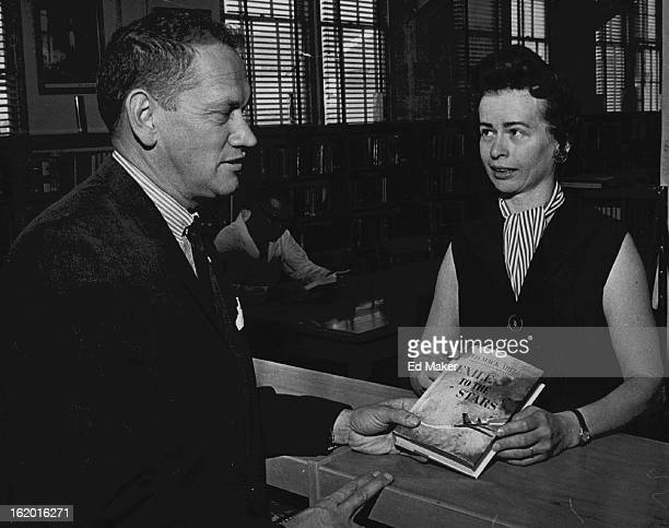 OCT 11 1963 OCT 23 1963 Novelist Gives Book to Lowry Ed Mack Miller novelist and United Air Lines flight instructor presents copy of his recently...
