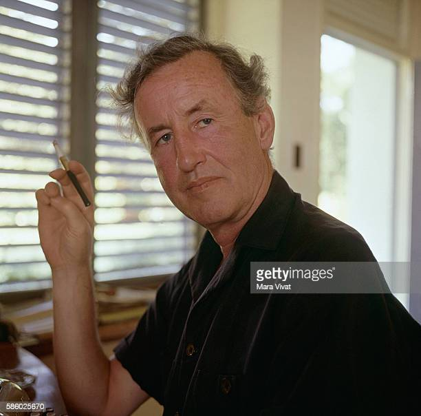 Novelist Ian Fleming creator of James Bond 007 sits at his typewriter while in Jamaica for the filming of the movie Dr No