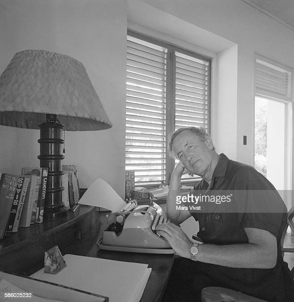 Novelist Ian Fleming creator of the James Bond 007 series looks up from his typewriter