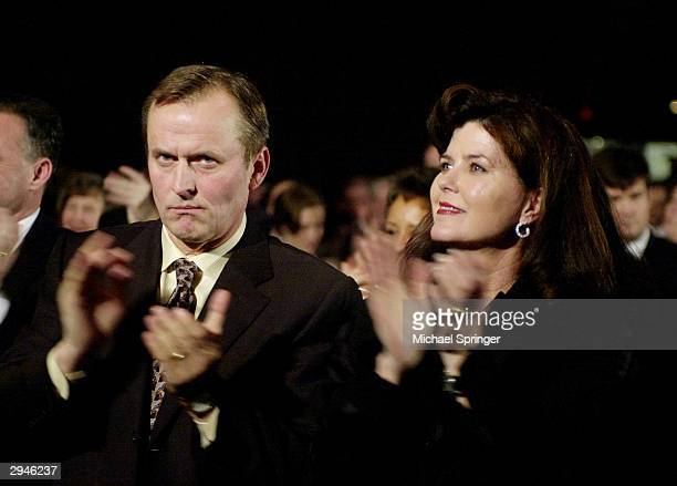 Novelist John Grisham and his wife Renee applaud during Virginia Democratic Party's annual JeffersonJackson Day Dinner February 7 2004 in Richmond...